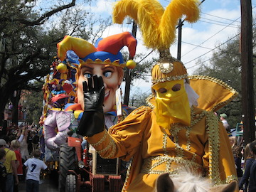 A captain of a New Orleans Mardi Gras parade generously greets onlookers.