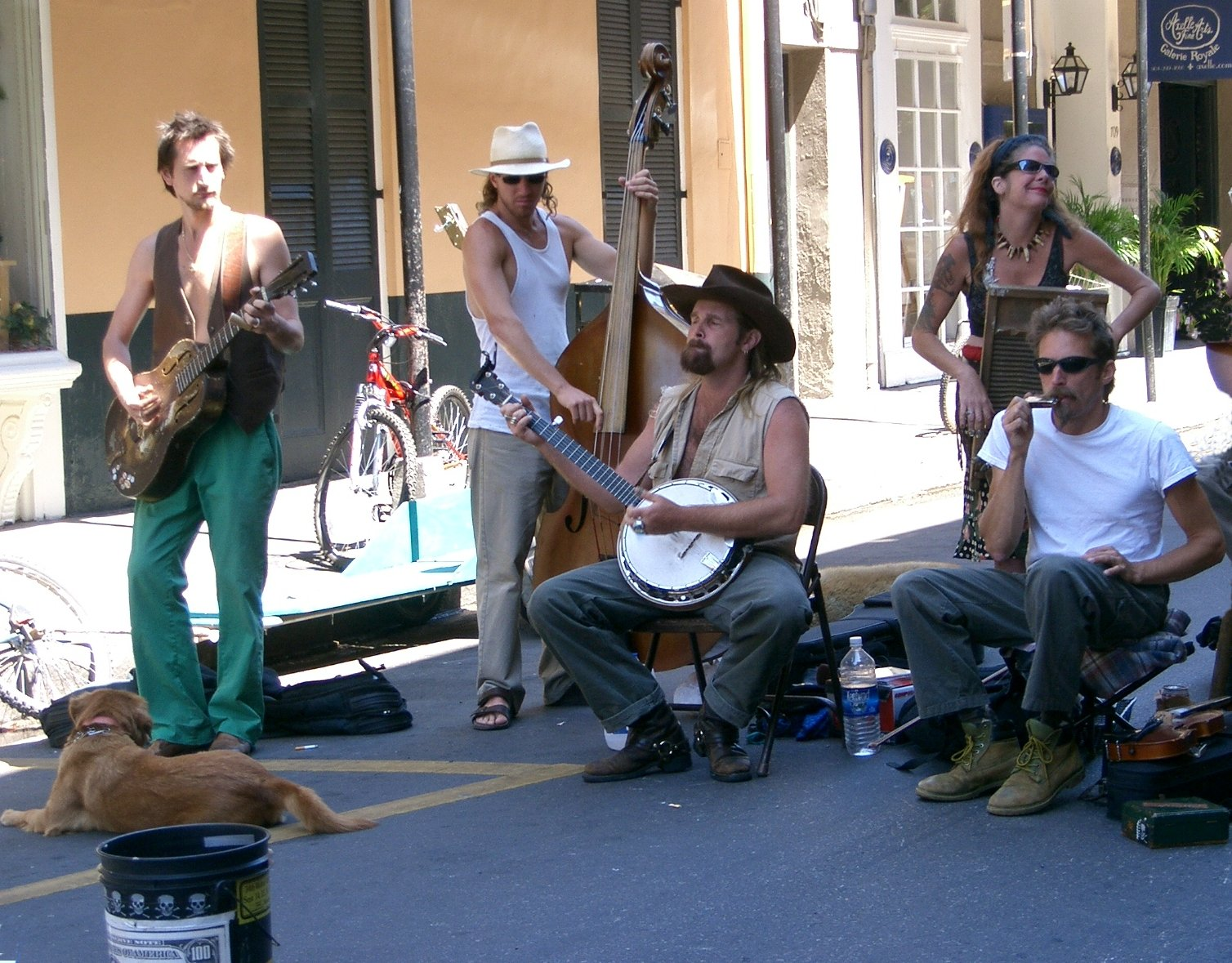 Musicians play on the streets of the New Orleans French Quarter, a quotidian, ubiquitous sight.