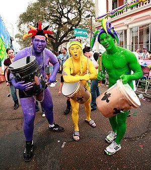 New Orleans Mardi Gras. Three revelers painted...