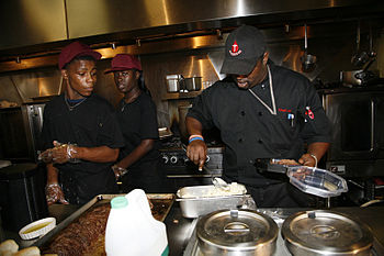 Kitchen workers at Cafe Reconsile, New Orleans...