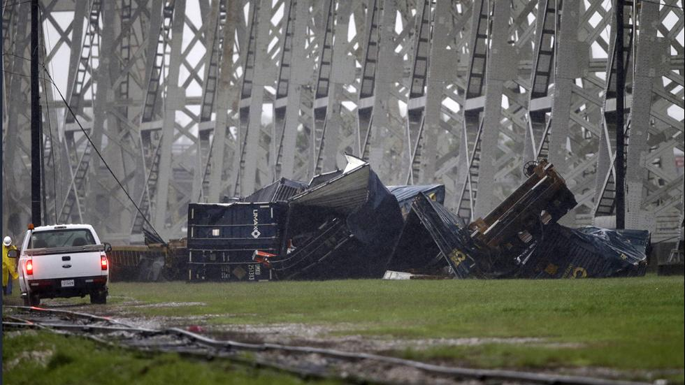 The crumpled wreck of train cars blown off during massive storm from Huey P. Long bridge. -- weather.com